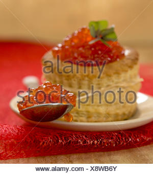 Tartlet with red caviar on plate. - Stock Photo