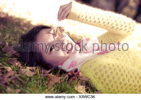 Woman laying in grass - Stock Photo