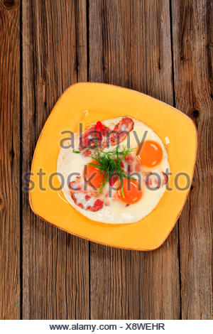 Freshly fried eggs with bacon birds-view - Stock Photo