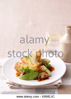 Plate of chicken and avocado - Stock Photo
