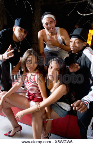 Group of young men and women in hip-hop fashion - Stock Photo