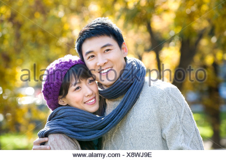 Young Couple Wrapped in a Scarf - Stock Photo