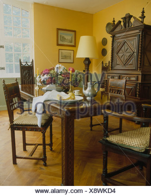 Antique Chairs And Table With Pewter Coffee Pot In Yellow Country Dining Room Parquet Flooring