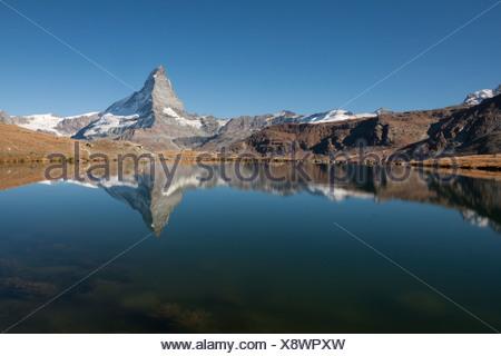 Mt Matterhorn, 4478 m, reflected in Stellisee Lake, Zermatt, Canton Valais, Switzerland, Europe, PublicGround - Stock Photo