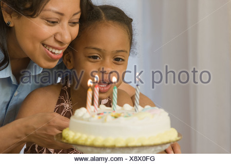 Hispanic woman celebrating her daughter's birthday - Stock Photo
