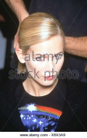 Helmut Lang Backstage New York A W German supermodel Claudia Schiffer having her side parted sleek hair pulled back into tight - Stock Photo