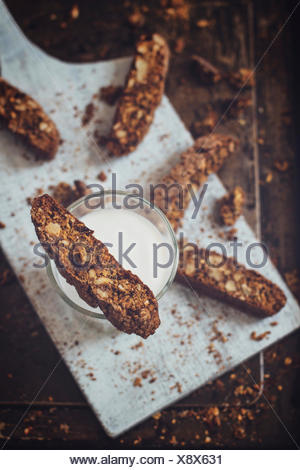 Homemade biscotti, high in fiber, with whole wheat flour, walnuts, dried plums and mixed seeds. Crispy and crumbly, they are per - Stock Photo