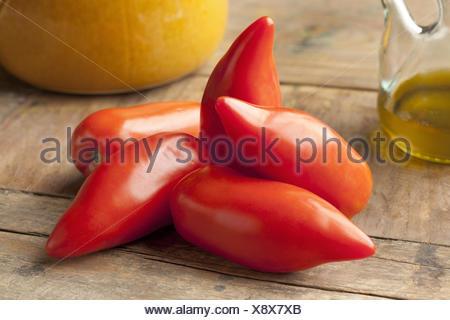 Whole fresh Cornue des Andes tomatoes. - Stock Photo