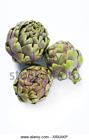 Close-up studio shot of organic artichokes - Stock Photo