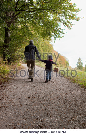 Father and son going for a walk - Stock Photo