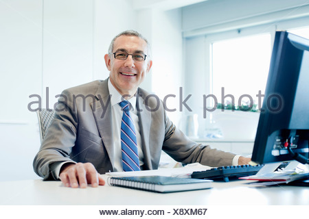 Businessman at office desk - Stock Photo