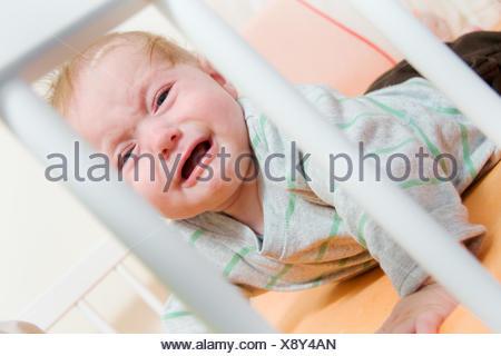 bed sad baby - Stock Photo