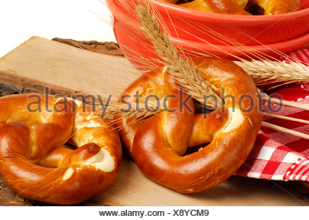 Pretzels and grain ears - Stock Photo