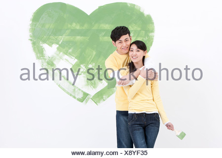 Happy young couple doing DIY home improvement - Stock Photo