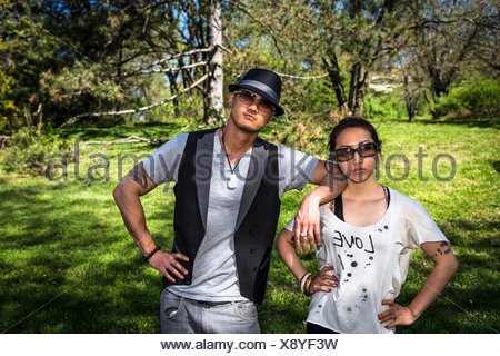 Couple wearing sunglasses, portrait - Stock Photo