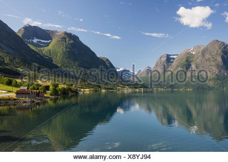 Mountains reflected in the Oppstrynsvatn Lake, Jostedalsbreen glacier at back, stryn, See Oppstrynsvatn, Sogn og Fjordane - Stock Photo