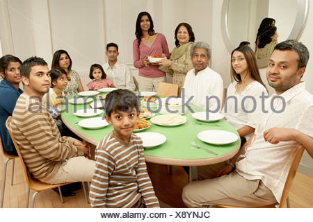 Large family at dining table - Stock Photo