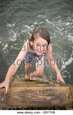 Sweden, Swedish West Coast, Halland, Onsala, Portrait of boy (10-11) swimming in sea - Stock Photo