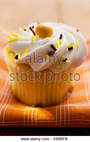 Muffin with cream topping FoodCollection - Stock Photo