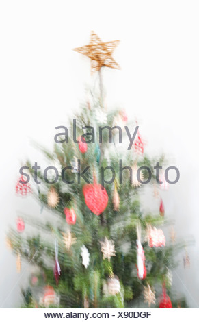 Blurred image of decorated Christmas tree - Stock Photo