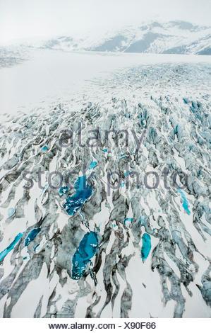 Aerial view of moulin's on the Taku Glacier, Juneau Icefield, Alaska. - Stock Photo