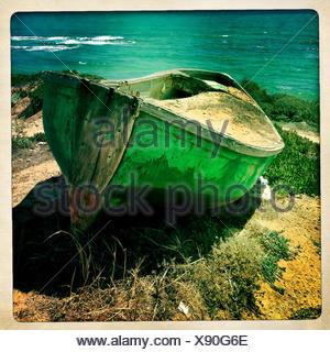 Old boat on coast line - Stock Photo