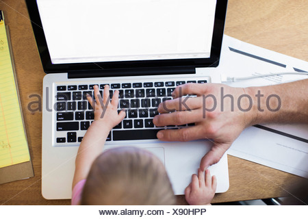 Father and baby girl using laptop - Stock Photo