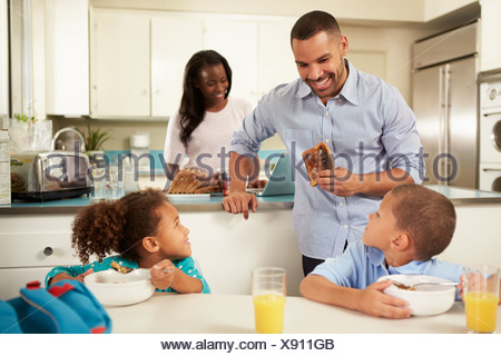 Family Eating Breakfast At Home Together - Stock Photo