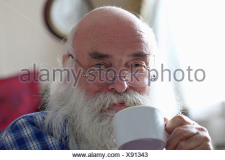 Senior man drinking tea - Stock Photo