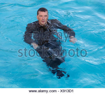 Senior business man in deep water - Stock Photo