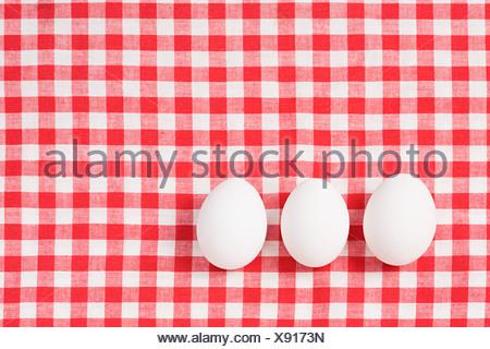 Eggs on a tablecloth - Stock Photo