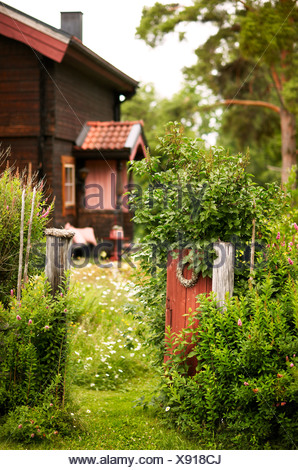 Rustic house with open front gate - Stock Photo