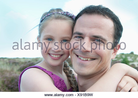 Father and daughter smiling together