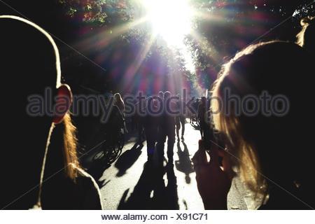 Silhouette People Walking On Road - Stock Photo