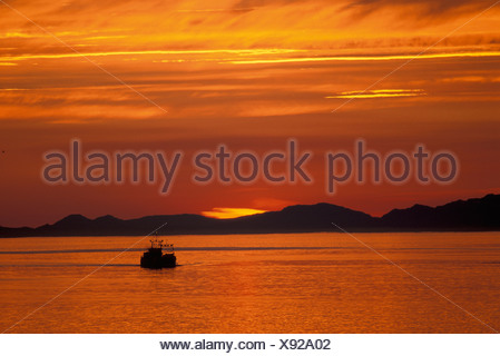 Sunset, Passage, near Petersburg, Alaska, USA, outlined, orange, sunrise, twilight, dusk, dawn, evening, night, boat, lake - Stock Photo