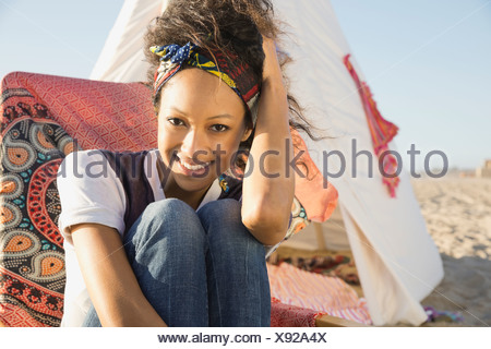Portrait of woman relaxing on beach - Stock Photo