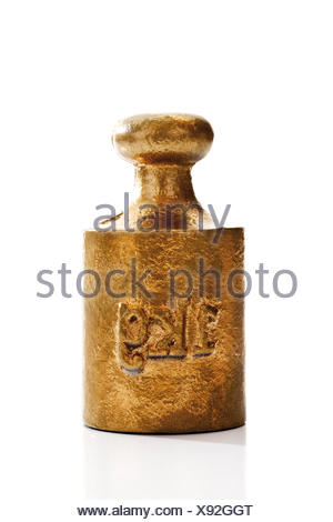 Golden weight, 1 kg - Stock Photo