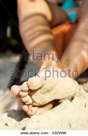 Sandy feet at the beach - Stock Photo