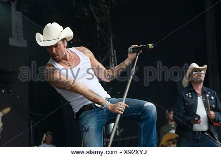 Singer Alec Voelkel of the German band The BossHoss live at the Heitere Open Air festival in Zofingen, Aargau, Switzerland - Stock Photo