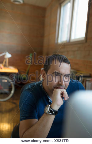 Focused creative businessman working at computer - Stock Photo