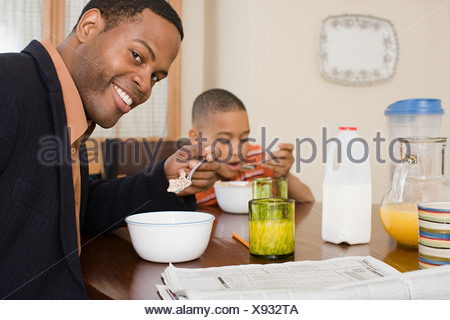 Father and son having breakfast - Stock Photo