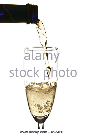 Pouring sparkling wine into champagne flute - Stock Photo
