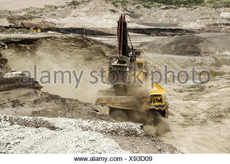 excavator at work in an open-pit mine - Stock Photo