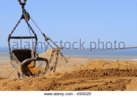 dragline excavator dumping excavated material - Stock Photo