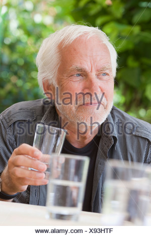 man with glass of water - Stock Photo