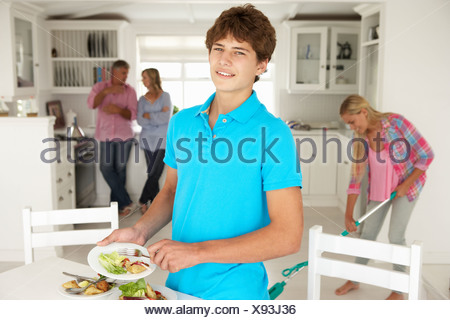 Teenagers helping with housework - Stock Photo