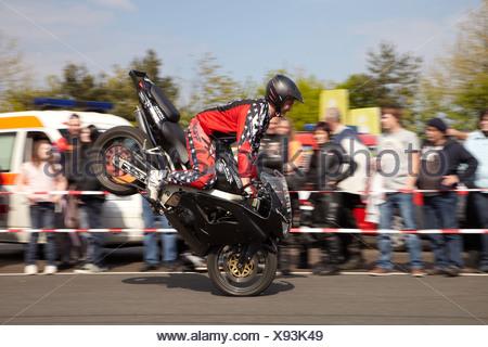 Motorcycle stuntman Mike Auffenberg showing a stoppy, Koblenz, Rhineland-Palatinate, Germany, Europe - Stock Photo
