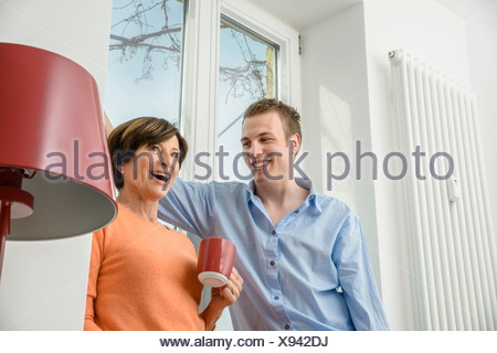 Woman and grown up son talking - Stock Photo
