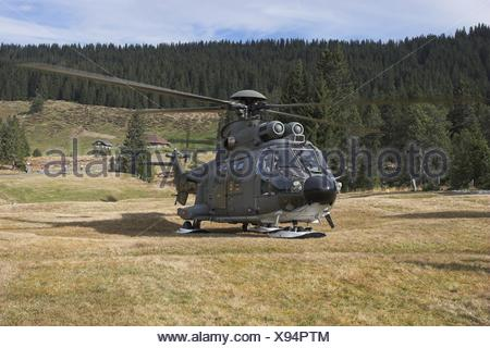 mountains alps aircrafts switzerland manoeuvre helicopter fascination - Stock Photo