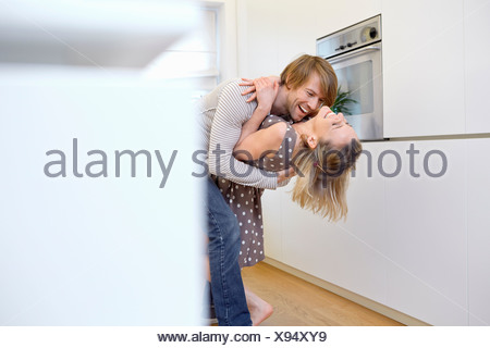 Couple dancing in kitchen - Stock Photo